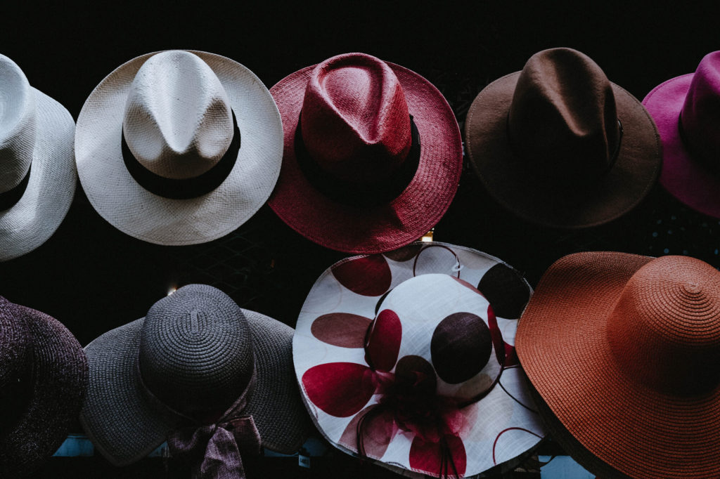 A photo of cowboy hats of multiple colors and designs